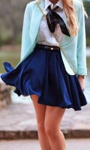 teal cardigan with white button up and blue skirt