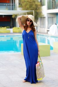 blue maxi dress with hat and canvas bag