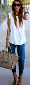 casual white blouse with blue pants and neutral accessories