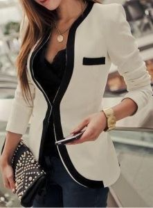 creme blazer with black piping and jeans